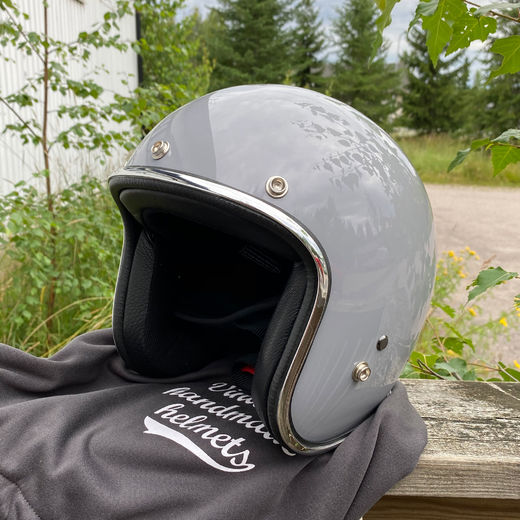 Grey open faced helmet with chromed trim